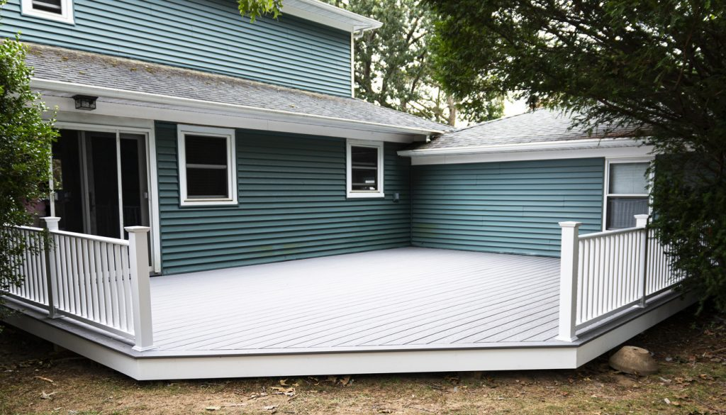 New composite deck in residential backyard