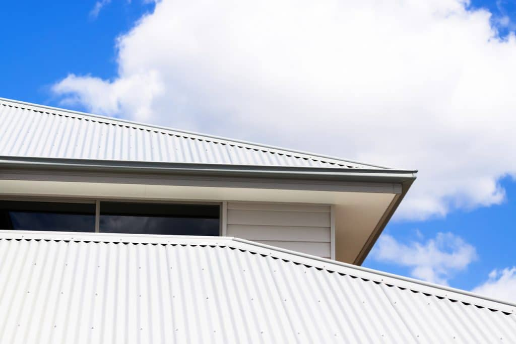 Low angle view of corrugated iron roof, copy space