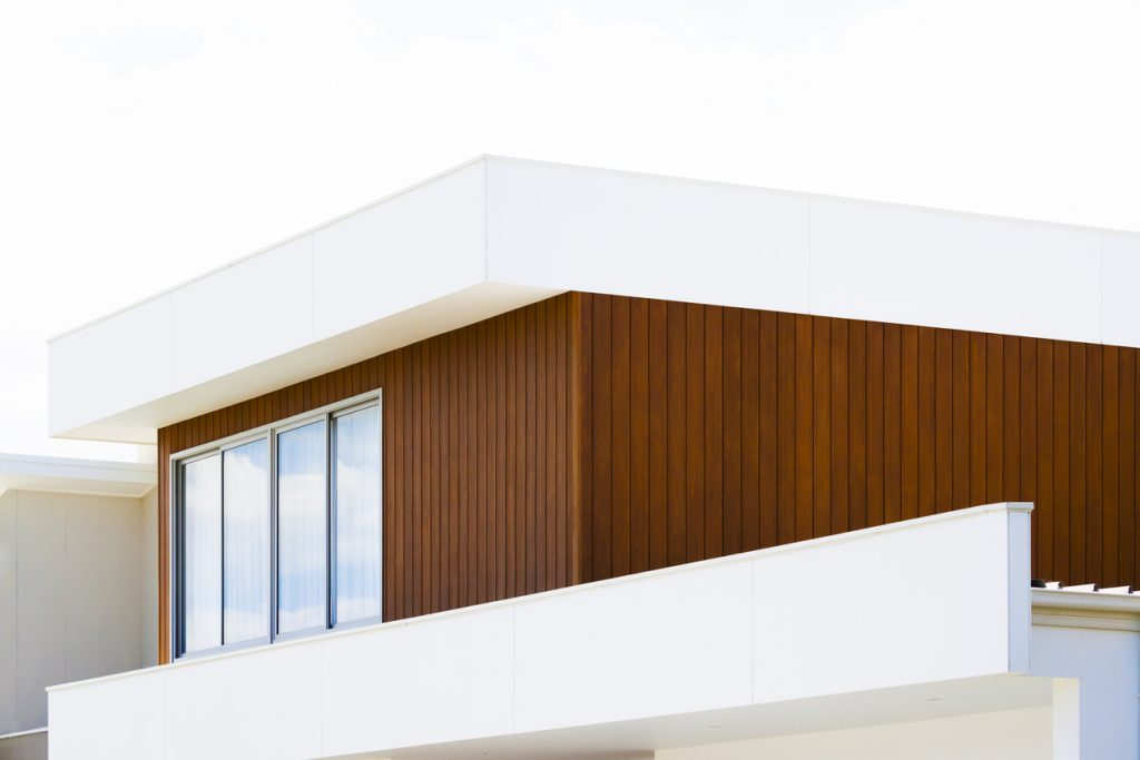 Closeup top part of contemporary new house with copy space