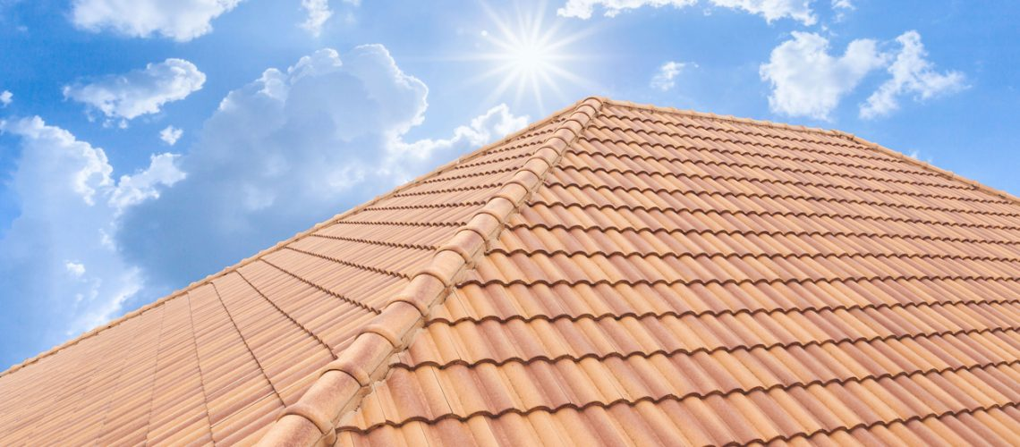 Roof tiles and sky sunlight. Roofing Contractors concept Installing House roof.