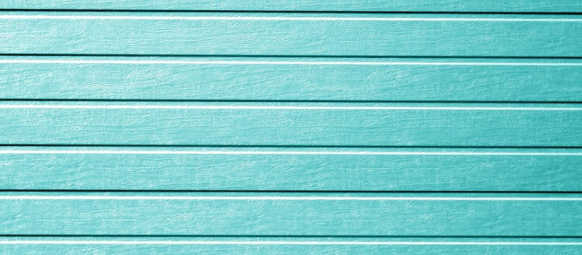 Plastic siding wall texture in cyan color. Abstract background and texture for design.